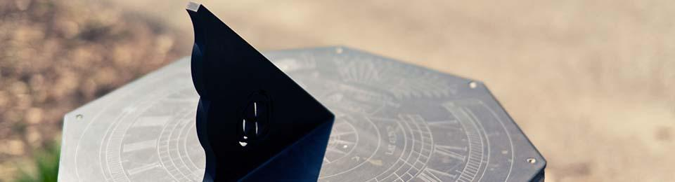 image of a sun dial outside of the Burke Science Building entrance at McMaster
