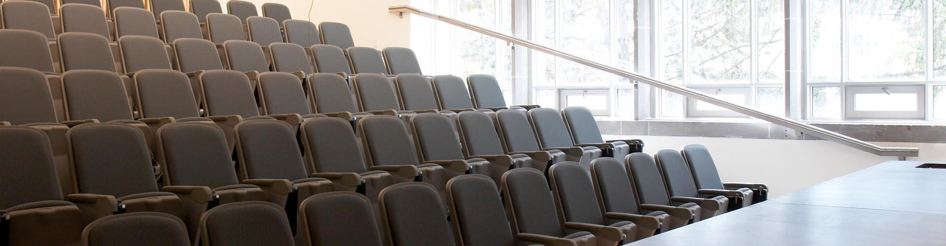 Image of classroom in Hamilton Hall with rows of chairs
